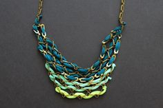 """.:* L - Beautiful Ombre Green/Blue chain and fabric necklace DIY. [From Brit.co: """"Materials:  - chain   - wire cutters  - needle nose pliers  - spandex strips  - gold jewelry loops  - scissors  - tape""""]"""