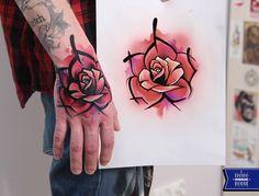 rose hand tattoo