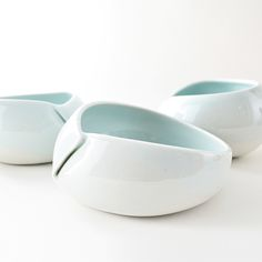 """white porcelain bowl. approx 5"""" wide x 3.5"""" high. height varies slightly for each bowl.wheel thrown, then hand-altered.glazed glassy clear, with brown marks at each fold.food/microwave safe. handwash preferable.all items in this store are made in the wabi sabi tradition. crazing, crackling, and other irregular textures, marks and surfaces are part of the work."""