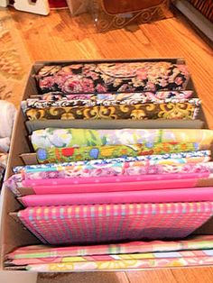 Easy fabric storage. Cut cardboard to fit box. Wrap fabric around cardboard. You can see everything you have!