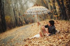 adorable! falling leaves + pile of leaves + umbrella
