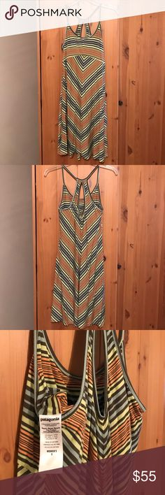 Patagonia Spright Dress Striped, a-line cotton dress with keyhole back. Built in support shelving (minimal coverage). Multi-colored consists of peachy orange, grey toned light blue, dark grey and yellow. Probably worn twice. Patagonia Dresses