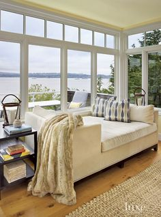 Best living room furniture for rooms with view. This Lee Industries chaise is low and doesn't inturrept the water view in this living room. #View #Furniture #Lowfurniture GR Interiors.