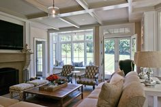 st. nicholas - Nightingale Design. Coffered ceiling, transoms, grasscloth, trim. Upholstered pieces, rustic coffee table.