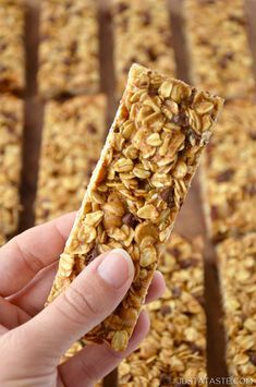 Skip the store-bought snacks and whip up this easy recipe for soft and chewy Homemade Peanut Butter Granola Bars studded with mini chocolate chips.   recipe from justataste.com #recipes #healthy #snacks #peanutbutter