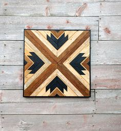 Enhance your home, office or man cave with this one of a kind hand crafted wall decor. It is made of reclaimed lath, stained and arranged in different shades to give a very unique design. It has a inlaid strip of narrow lath to add depth to this unique pattern. It can be hung