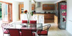 Open-plan kitchen-diner/garden room with folding-sliding doors