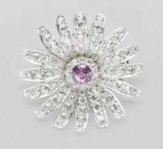 Pink Sapphire and Diamond Flower Pendant Brooch   Rhodium-plated platinum, gold, one round pink sapphire ap. 3.75 cts., 92 diamonds ap. 9.70 cts., c. 1905, ap. 14.2 dwt.