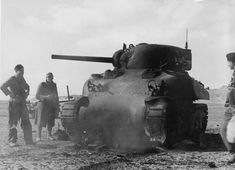 Destroyed M4A1 Sherman tank and Afrika Korps troops Tunisia