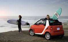 Smart car with beautiful girls on beach