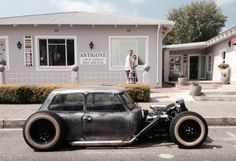 Check out this modded Mini Cooper. Classic rat rod style. I'm all over this.  https://www.thetitlestore.ca/car-of-the-day-rat-rod-style-mini-cooper/