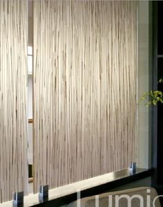 room partitions, cabinet doors, light filters etc. with natural grasses/flowers/designs between acrylic layers - by Lumicor- this is palapa grass