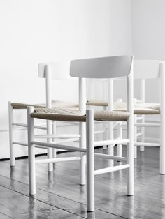 Børge Mogensen's chair J39 in a white version with a seat in hand woven natural paper cord. Photographer: Mikkel Mortensen - -