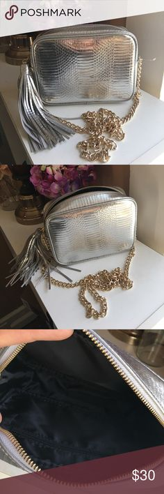 NWOT Victoria's Secret Crossbody. ✨ BNWOT. Beautiful, excellent quality bag. Took off paper tag, never had a chance to use it. Gold chain Crossbody strap. Tassel zipper. No scuffs, stains, or tears. Zipper is perfect. Small zip pocket inside. My baby girl even loves the bag 😻 PINK Bags Crossbody Bags