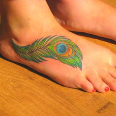 For about a year I wanted a tattoo just like this, in the exact location!!!!... But with better detail of course. The feather along the side of my foot with the eye in the middle.