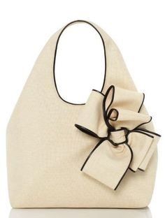 Kate Spade. Ok, I love my purse & will carry it for life (Sorry Shayla), but this is pretty cute too :)