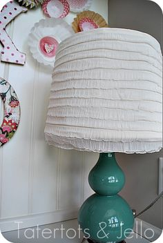 I like this ruffle fabric lampshade idea for the girls' room, but am thinking it would make a great small shower curtain for their shower stall, as well.
