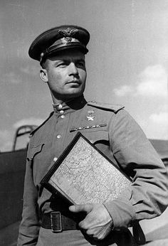 World War Two. Captain Makovsky, Hero of the Soviet Union, on his way to his plane with his assignment. This veteran airman fought in the Kuban, Novorossiisk, the Crimea, and took part in the battles for Sevastopol. He holds 5 orders and has 40 enemy planes to his credit. Today he is fighting in East Prussia. Pin by Paolo Marzioli