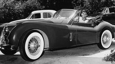 Shirtless American actor Michael Landon (1936 - 1991) sits in his Jaguar XK140 and smiles, mid 1950s. (Photo by Hulton Archive/Getty Images)   - Esquire.com