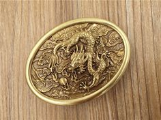 Ellipse Dragon Ball Embossed Solid Brass Belt Buckle