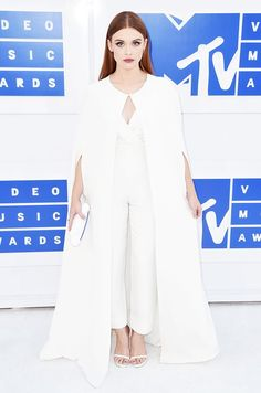 WHO: Holland Roden WEAR: Kayat ivory silk crepe jumpsuit and matching full-length cape; Stuart Weitzman Nudist sandals.