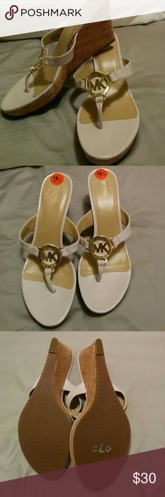 Michael Kors Brand New wedge sandals Michael Kors Brand New wedge sandals  Platform is 1 inch Heel is 3.5 inches  Sorry, no trades! Michael Kors Shoes Sandals