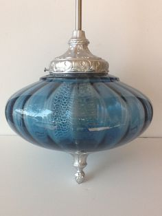 Free shipping Vintage blue glass pendant lightFREE SHIPPING. $149.00, via Etsy.