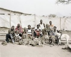 South African photographer Pieter Hugo captured images of the men and their hyenas in Lagos, Nigeria, creating very unusual images of men and their animals. African Tribes, African Art, Hyena Man, Nigeria Travel, Nigeria Africa, People Of Interest, Man Images, Open Window, People Of The World