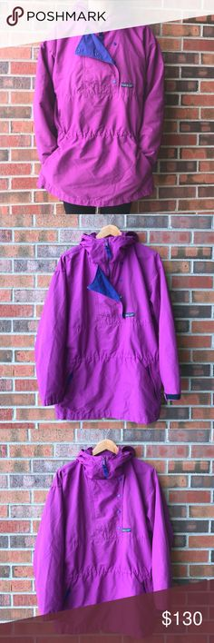 vintage🌵patagonia oversized jacket 90s patagonia jacket in purple with blue accents in good/excellent condition • labeled size 12, can fit sizes medium and large • half zip up with button front closure • uni-front (kangaroo) pocket with zippers on both ends, 1 pocket next to zipper (near logo), adjustable hood with small wire structure & adjustable velcro cuffs • 100% nylon with a silky feel • truest color is in the last 2 photos •  M A K E  AN  O F F E R ⭐️ Patagonia Jackets & Coats