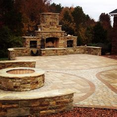 This outdoor living project in New Salem, NC had a custom masonry Fire pit and an outdoor fireplace with wood boxes on each side. The Techo Bloc paver patio was a combination of Blu slate, Parisien soldier row and Antika infill.