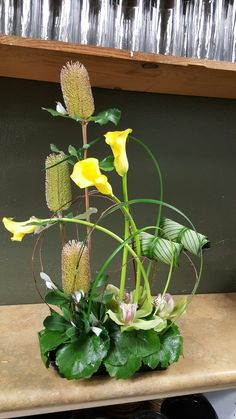 Yellow and green flower arrangement for wedding and events