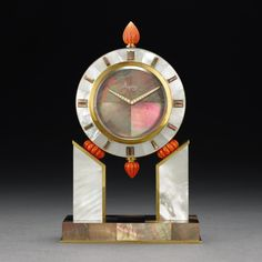ASPREY ART DECO MOTHER-OF-PEARL CLOCK A FINE AND RARE YELLOW GOLD, MOTHER-OF-PEARL AND CORAL DOUBLE DIALED MANTEL CLOCK CIRCA 1985