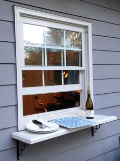 Deck window shelf.  Easy pass thru to the outside from kitchen!