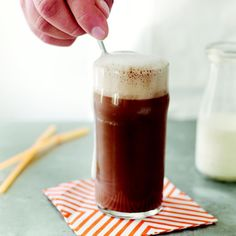 The name egg cream is misleading—in actuality, the soda fountain classic contains no eggs and no cream. The three winning elements are milk, flavored syrup, and seltzer. For an icy beverage like top soda jerks used to craft, it's best to frost glasses in the freezer.