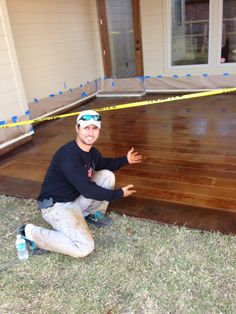 Concrete stained to look like wood flooring.  This faux wood look will never weather outdoors in the elements.  Created by Keefe Duhon of New Iberia, LA.