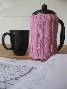 Hand-knit pink cable ribbed cafetiere cozy, perfect for Valentine's Day!