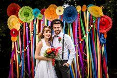 Ribbon Backdrop Pinwheels Lanterns Bunting Outdoor Rainbow Colourful Vintage Comic Book Wedding Ideas http://www.hayleypettitphotography.com/