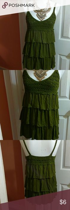 Cute Ruffle Top This top is cute with crochet details, ruffle layers, soft and comfortable fitting. Fabric feels like soft t-shirt material. In excellent used condition. Bundle and save. Color is a bit darker more like olive green. Forever 21 Tops
