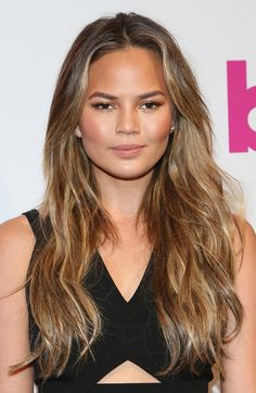 Get inspired by Chrissy Teigen's golden brown and try  VS Salonist 5/3 Medium Gold Brown shade.   - ELLE.com