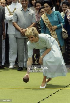 NOVEMBER 04 Diana, Princess of Wales, plays a game of boules on a visit to Sitanala Leprosy Hospital during her official visit to Indonesia