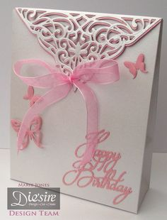 Marie Jones – Crafter's Companion - Die'sire Create-a-card: Toulouse - Centura Pearl Snow White Hint of Silver - Butterfly Lullaby: Flit and Flutter & Happy Birthday dies - Big Score - Cut n Boss - Collall Tacky glue - Other: Ribbon, glitter, pink card - #crafterscompanion