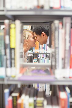 kissing behind the books.  Would be cute for a library engagement.