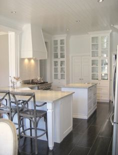 white kitchen. I like this island, with the countertop extended for bar stools