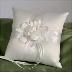 """WeddingDepot.com ~ Ring Bearer Pillow - Forever - White ~ Soft matte satin combined with a crossed ribbon pattern with floral cluster provides just the right look for this pillow. A pair of ring-tie ribbons extend outward from the pillow's center. Measures 7.5"""" square."""