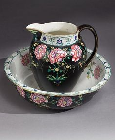 Cetem Ware Polychrome Chinoiserie Floral Decoration, painted black ground, water jug, and wash bowl.