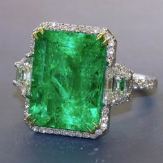 Impressive Emerald ring of Colombian origin. Emerald is nearly carats surrounded by small round diamonds and a pair of trapezoid-cut diamonds. Coming up this Spring at Dupuis Important Jewels. Emerald Jewelry, Gems Jewelry, Cute Jewelry, Pearl Jewelry, Gemstone Jewelry, Diamond Jewelry, Jewelry Gifts, Antique Jewelry, Vintage Jewelry