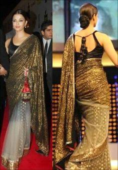 Aishwarya Rai In Cream Colored Net Saree In Cannes Award