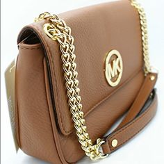 NWT,Michael Kors,leather khaki shoulder purse New with tags, Michael Kors, leather shoulder khaki purse! -could have one longer strap or two shorter ones! -gold metal with a khaki leather.. Will sell for less on mercariapp! Michael Kors Bags Shoulder Bags
