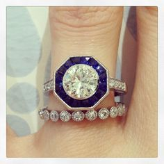 Wedding Ring Wednesday! This 1.08 carat bezel set stone is surrounded by beautiful blue sapphires. It is paired with our popular Gabriella band!