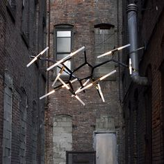 Lindsey Adelman: 20 bulb Agnes chandelier in high gloss black and brushed brass,